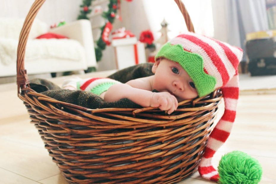 cute little baby inside a basket