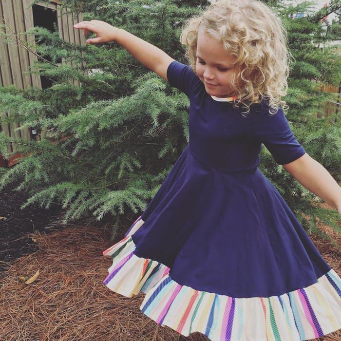 baby wearing a dress