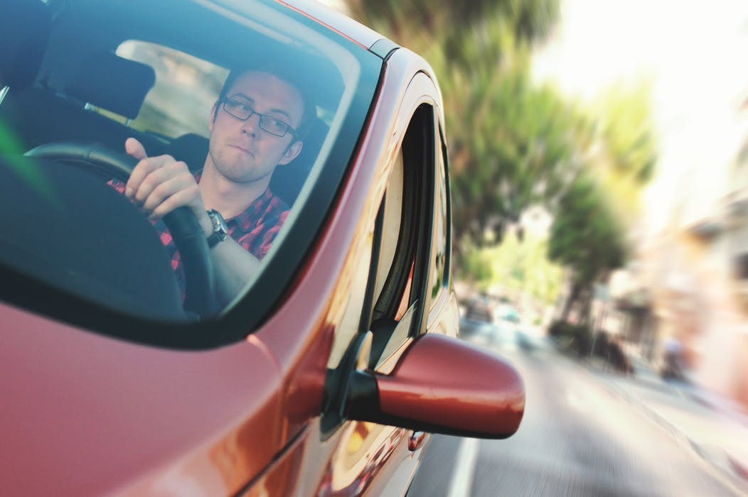 man inside a car while driving